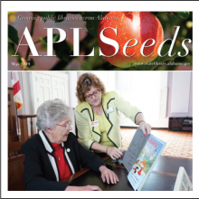 Thumbnail Image of Governor Kay Ivey and APLS Director Nancy Pack looking at children's book