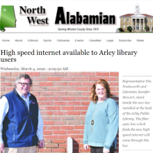 Thumbnail Image Representative Tim Wadsworth and Librarian Jennifer Stewart, stand beside the new box installed at the back of the Arley Public Library.