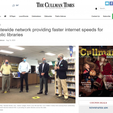 Thumbnail Image of newspaper article with picture of 4 men standing to talk in library.