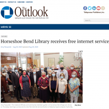 Thumbnail Image of group of men and women standing in library