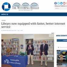 Thumbnail Image of 2 men standing in library.