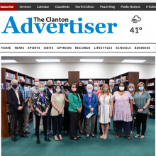 Thumbnail Image of group of 17 men and women standing in library